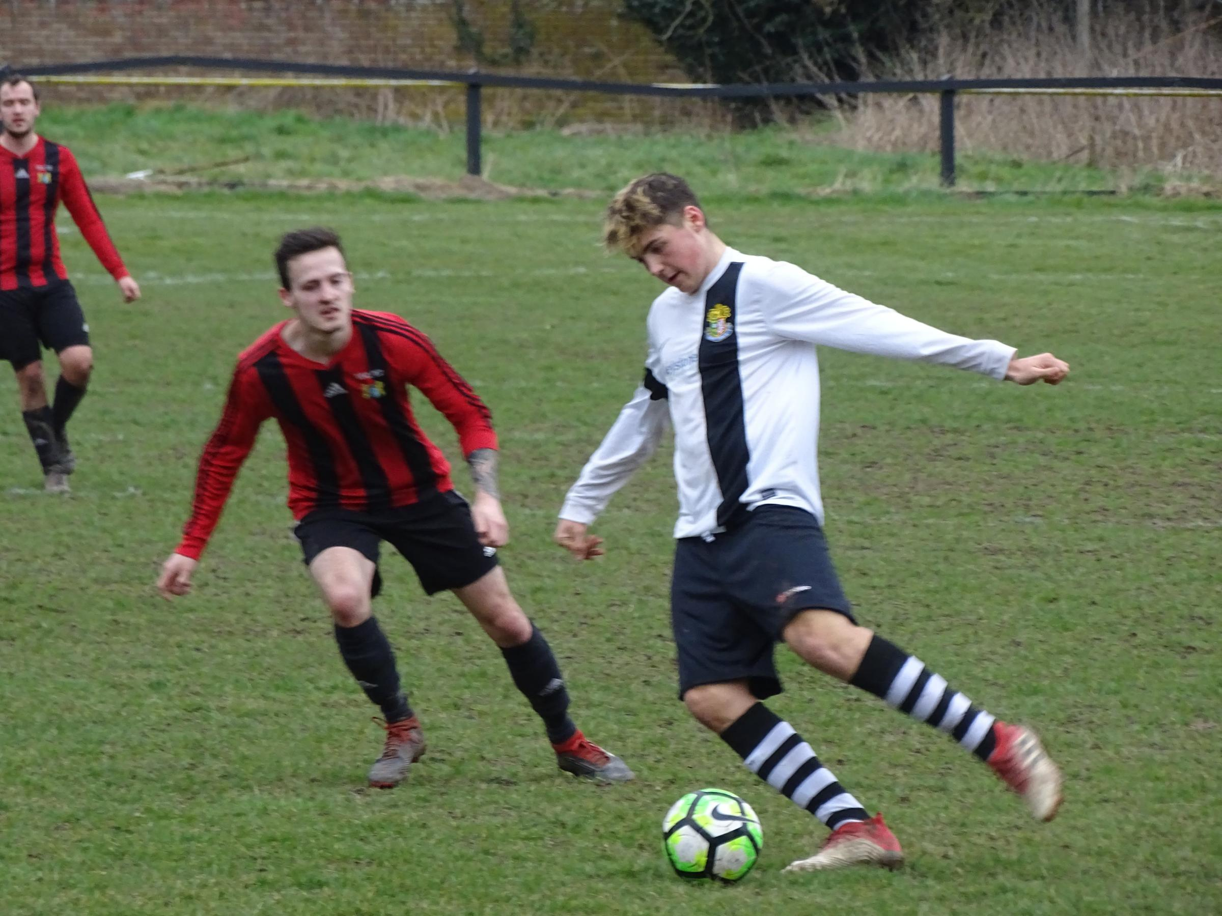 Ben Febery in action during Ledbury Town's 3-1 defeat to Clee Hill United at New Street. Picture: CHRIS PONTER