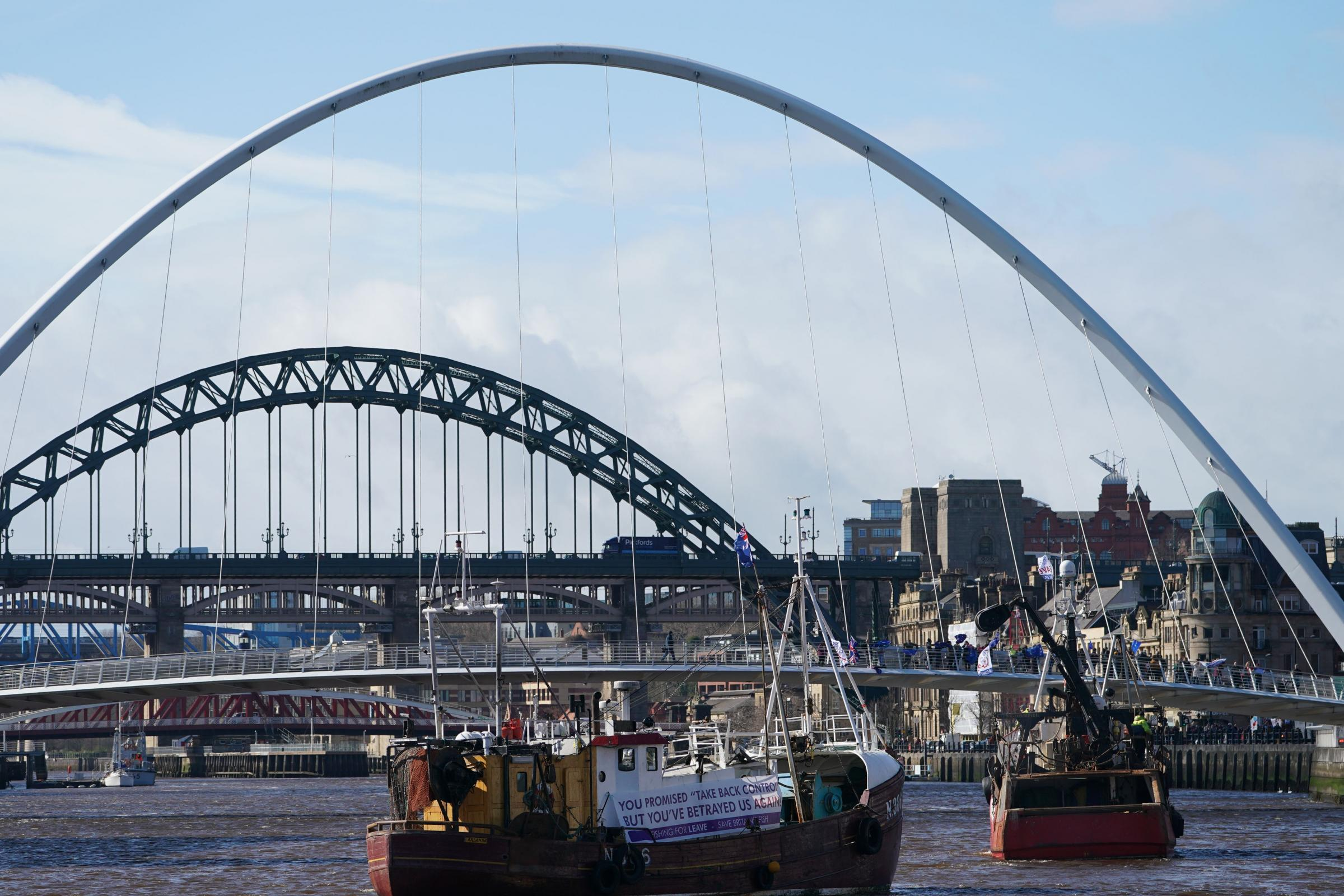 Fishing boats sail up the River Tyne in support of Brexit