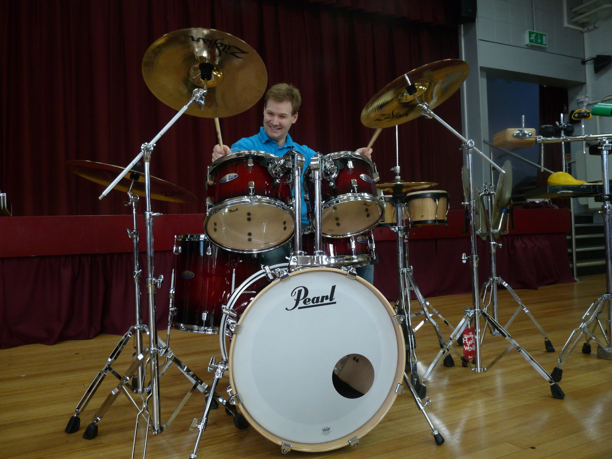 Max Beswick playing the drums