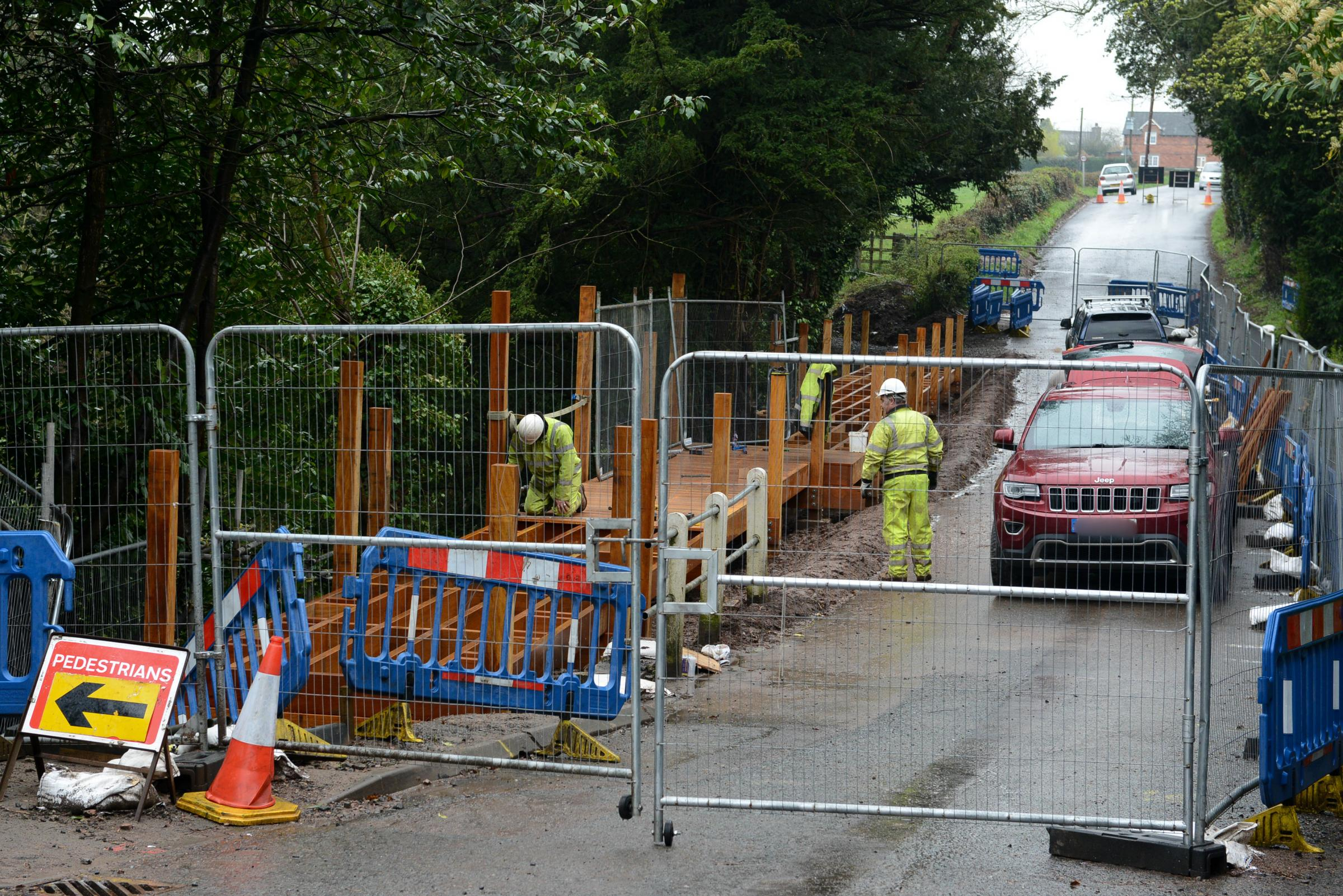 Workmen constructing a wooden walkway around Belmont Pools on Haywood Lane, Hereford.