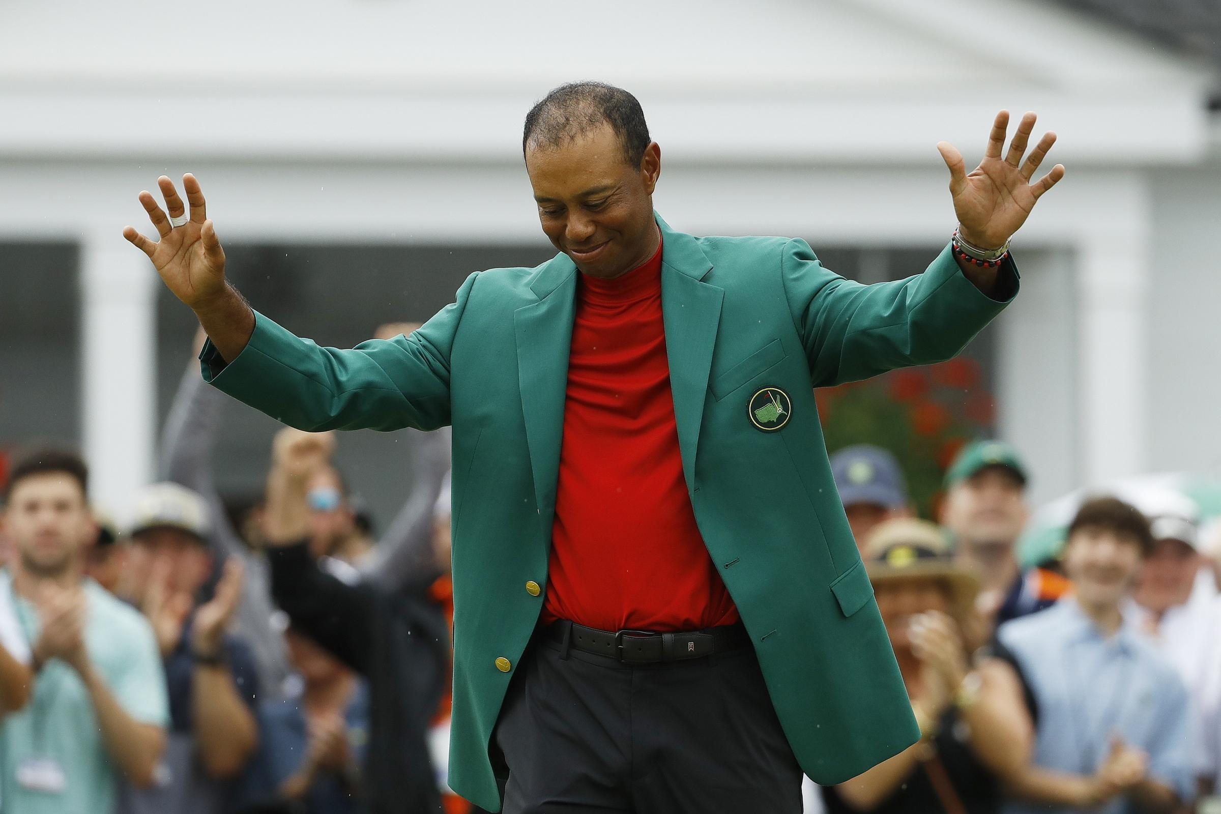 Tiger Woods celebrates after donning the green jacket at Augusta