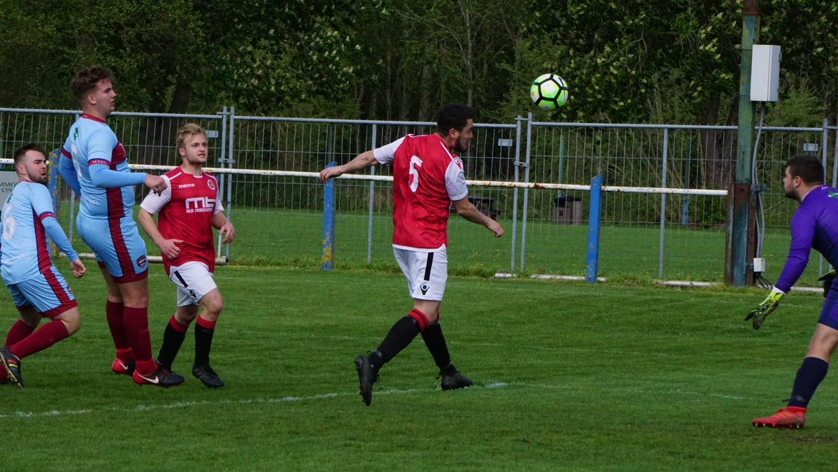 Matt Hunt scores the winning header for Droitwich Spa against Malvern Town Reserves. Picture: MAT MASON