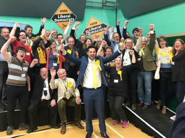 VICTORY: Councillor Joe Harris leads the Lib Dem celebrations after securing a majority on the council for the first time
