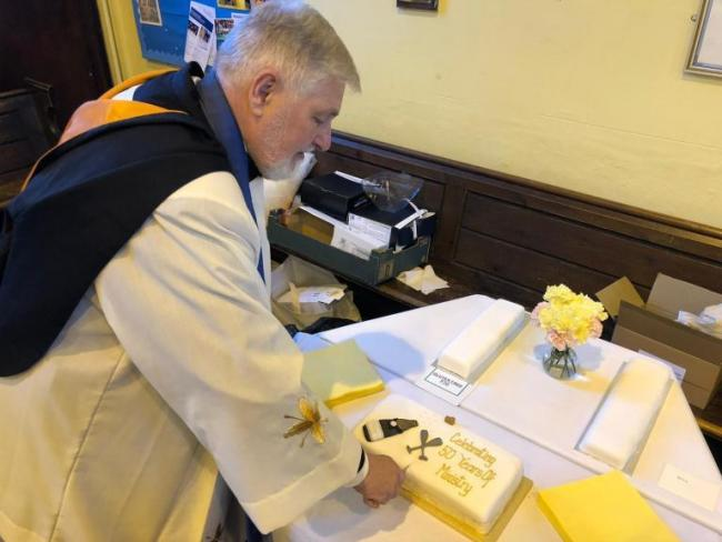 Malcolm Robertson celebrated 50 years of ministry as a reader with Prosecco and a cake.