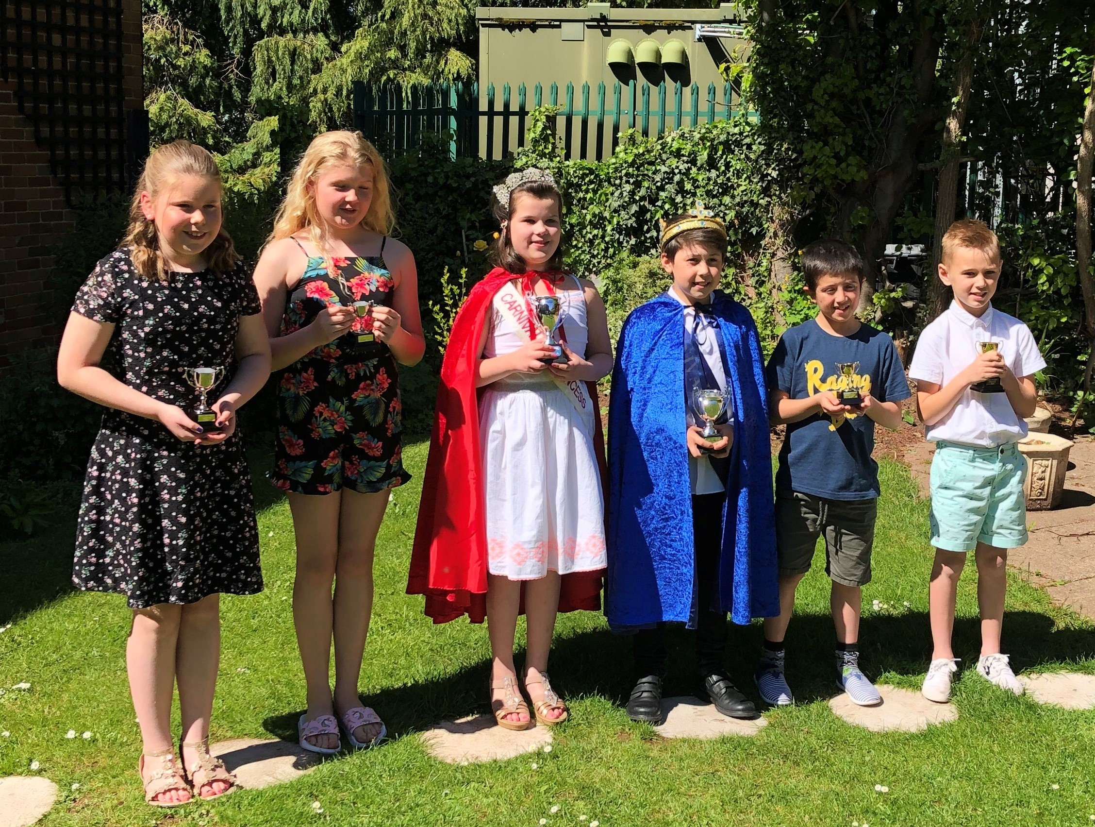 Ross on Wye Carnival Princess Phoebe with attendants Molly and Eboney and Carnival Prince Daniel with consorts Bobby and Cody. Photo: Ross Carnival