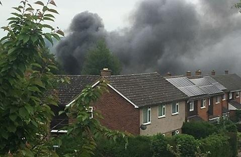 Smoke rises above homes in Redhill, Hereford.
