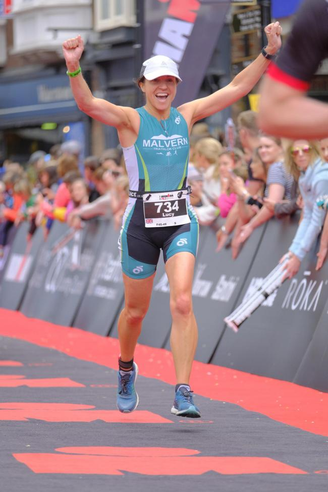 Lucy Bennett-Poole celebrates crossing the finish line